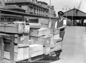 Porter handling parcels at Newcastle Railway Station, circa 1930s.