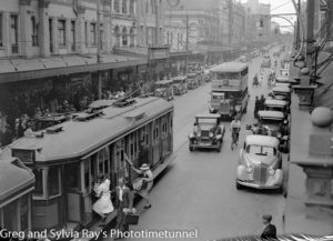 Trams, bus and cars in busy Hunter Street Newcastle. Christmas shopping 1937.