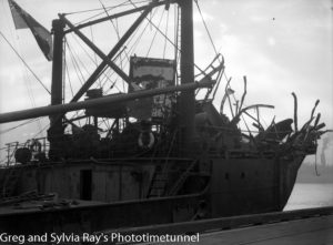 The torpedo-damaged ship Allara in Newcastle Harbour, July 1942. (7)