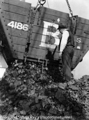 Loading coal aboard a ship. Circa 1930s.