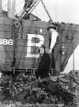 Loading coal aboard a ship. Circa 1930s. (2)