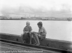 Two boys on the Newcastle waterfront, March 1937. Ship in the background is the Danmark.