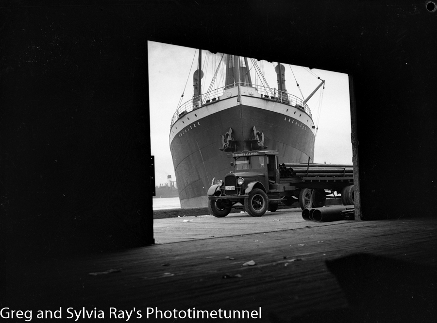 Ship Anchises on Newcastle Harbour, with a Stewarts and Lloyds truck carrying lengths of pipe. December 22, 1936.