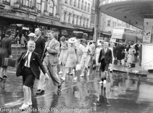 Christmas shopping on a wet day near the Duke of Kent Hotel, Hunter Street Newcastle, December 20, 1940.