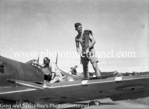 Arming a Spitfire fighter at Williamtown RAAF base Newcastle. April 1, 1943.