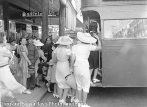 Crowds boarding a double-decker bus in Hunter Street during World War 2.