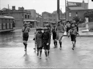 Boy scouts in Newcastle East on a rainy day. Circa 1940s
