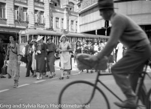 Cyclist and shoppers at Scotts Corner, Hunter Street, Newcastle. Circa 1940s