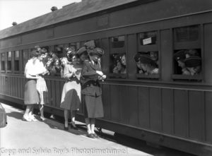 Group of female air cadets on a train in the Newcastle area.