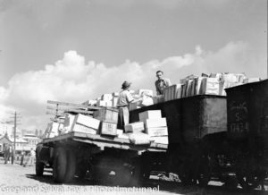 Foodstuffs being unloaded from a train onto a truck on Newcastle's waterfront, mid-1940s.