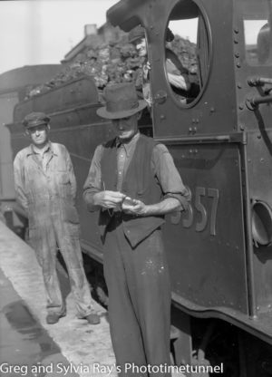 Train driver sets his watch, March 28, 1943.