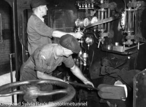 Fireman feeds the boiler in the cabin of a steam locomotive, December 19, 1940. (1)