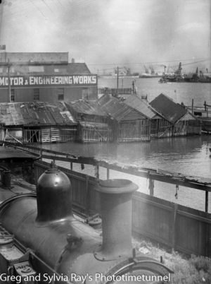 The old boat harbour on Newcastle Harbour, with steam engine in the foreground, January 23, 1939.
