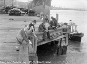 Men fishing from the wharf at Newcastle, circa 1940s.