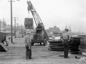 Shifting lumber on the Newcastle waterfront in the 1940s.