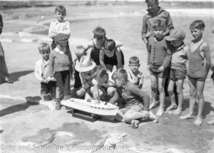Young boys with a model boat at the opening of the Young Mariners Pool, Newcastle, NSW, September 25, 1937.