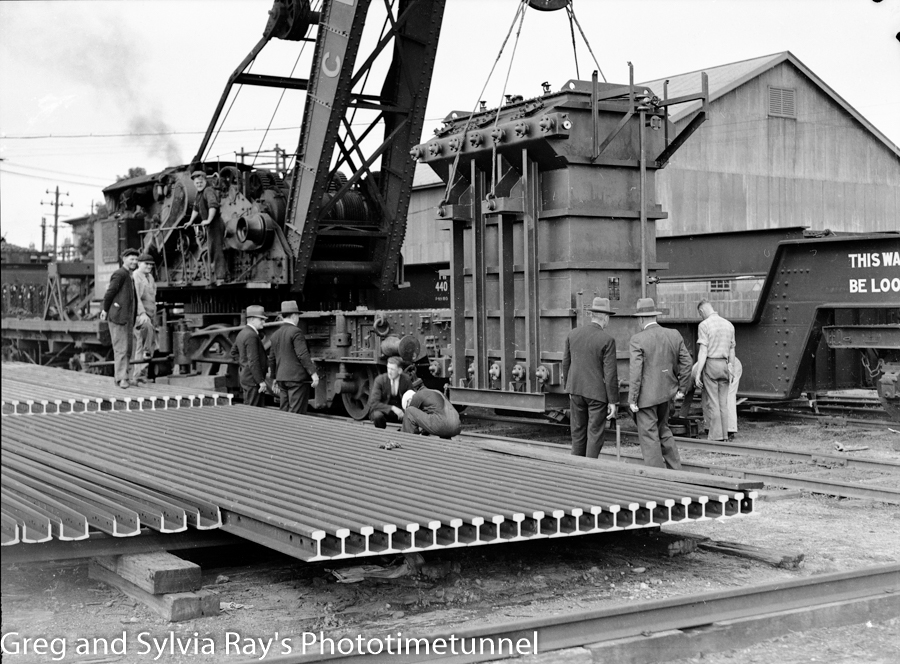 The Craven crane handles an imported transformer on the wharf at Newcastle, June 22, 1938.