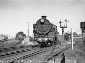 Locomotive 3667 leaving Cockle Creek Station, Lake Macquarie, near Newcastle, circa 1937.