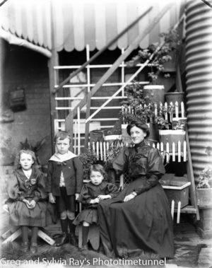 Woman and three children, portrait c1910.
