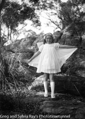 Young girl in fairy costume in bushland setting.
