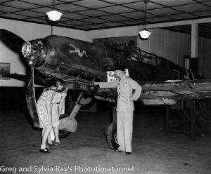 Captured German Messerschmitt 109e fighter, exhibited in Newcastle at John McGrath's Hunter Street showroom. January 1942.