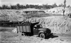 Tip truck at a Hunter Valley open-cut coalmine. Circa 1950s.