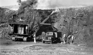 Steam shovel loading a tip-truck at a Hunter Valley open-cut coalmine. Circa 1950s.