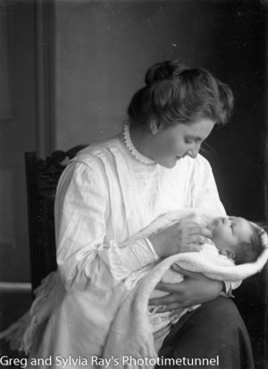 Woman holding baby.