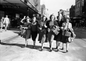 Smiling women: celebrations in Newcastle, NSW, for the end of World War 2, August 15, 1945.