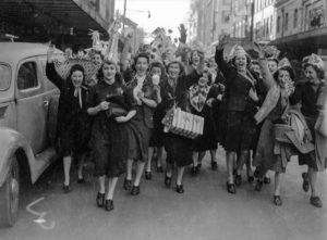 Girls celebrating in Newcastle, NSW, for the end of World War 2, August 15, 1945.