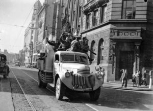 Men on council truck celebrating in Newcastle, NSW, for the end of World War 2, August 15, 1945.