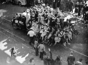 Overloaded truck: celebrations in Newcastle, NSW, for the end of World War 2, August 15, 1945.