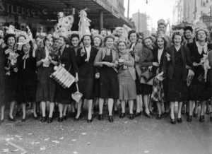 Hats, flags and confetti. Celebrations in Newcastle, NSW, for the end of World War 2, August 15, 1945.