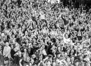 Joyful crowd celebrating in Newcastle, NSW, at the end of World War 2, August 15, 1945.