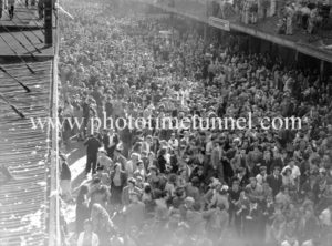 Huge crowd in Hunter Street Newcastle, NSW, celebrating the end of World War 2, August 15, 1945.