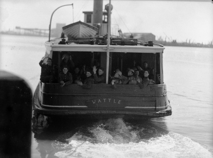 """Soldiers aboard the ferry """"Wattle"""" on Newcastle Harbour, October 20, 1938."""