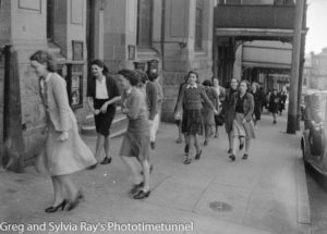 Daylight air raid shelter drill, Newcastle, NSW, September 1, 1942. Staff of The Newcastle Herald returning to their Bolton Street office after the drill.