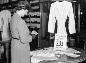 Ration coupon shopping in a Newcastle department store, June 1, 1942.