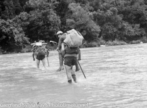 Marie Byles' 1935 expedition to the New Zealand Alps. Crossing the Mahitahi River.