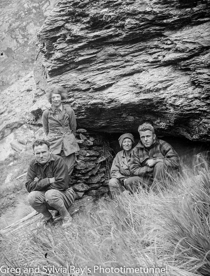 Alpine guides Frank Alack (left) and Harry Ayres with Australian expeditioners Marjorie Edgar Jones (left) and Marie Byles at a bivouac in New Zealand in 1935.