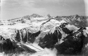 Marie Byles' 1935 expedition to the New Zealand Alps. View from Mt Strachan summit, with Zora Glacier in foreground and Mt Cook and Mt Sefton in background. (1)