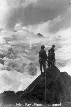 Australian lawyer Marie Byles' expedition to the New Zealand alpine country in 1935. Marie Byles, Marjorie Edgar Jones and guide on Crystal Peak, with the head of the Zora glacier in the background.