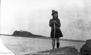 Young girl on the Stockton shore of Newcastle Harbour, circa 1920.