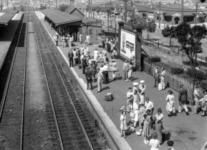 Waiting for a train at Broadmeadow Railway Station, Newcastle NSW, on New Year's Day 1946. (3)
