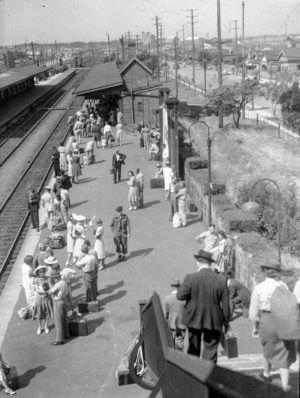 Waiting for a train at Broadmeadow Railway Station, Newcastle NSW, on New Year's Day 1946. (4)