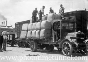 Wool bales on an AEC solid-tyred railway department truck in Newcastle East, NSW, circa 1930s.