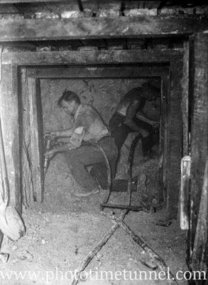 Men with jackhammers working on a tunnel at Adamstown, Newcastle, NSW, February 23, 1942.