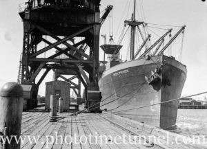Ship Iron Prince being loaded with BHP coal in Newcastle Harbour, November 5, 1935.