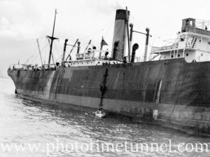 Boatmen boarding the ship Sagoland in Newcastle Harbour, NSW, October 1935.