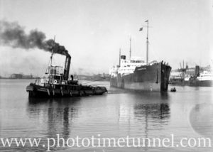 Ship Yarraville being towed by the tug Heroine in Newcastle Harbour, NSW, June 19, 1936.